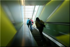 traffic on the green escalator (Toni_V) Tags: city longexposure girls urban motion blur green girl d50 movement europe zurich escalator perspective 2007 sigma1020mm shopville toniv 070929 toniv