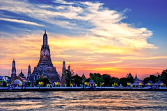 Temple of the Sun (Surrealize) Tags: travel roof light sunset sky orange reflection tree clouds river thailand temple gold golden dock ancient nikon colorful waves bangkok famous landmark flags spire international wat hdr steep arun chaophraya d700 surrealize