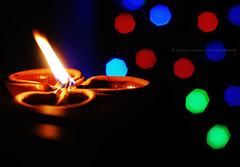 And God said: Let there be light and there was light... (Bhavna Saluja) Tags: lights dof bokeh diwali diya 50mmf18 nikond60 bokehlicious shapedbokeh letthelightshine