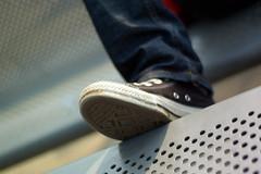 Put your feet up.... (Urban Disturbance) Tags: london nikon d70 converse chucks 50mmf18af nikoniste