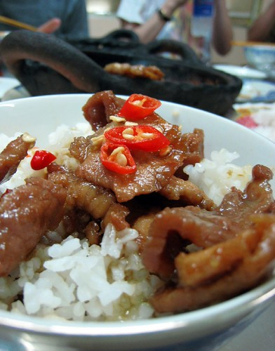 Clay pot pork topped with chilies on rice