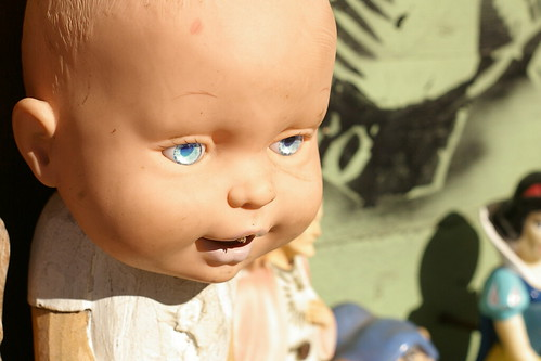 Creepy Baby outside a shop