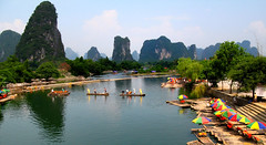 Guilin In Colour (Flying Fin) Tags: china umbrella mom guilin  supershot flickrsbest wowiekazowie colourfulumbrellas 286explore021007 globalbackpackers