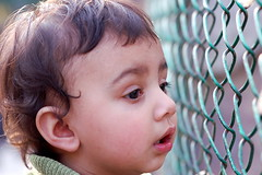 Caged (remudada) Tags: children child cage nikonstunninggallery
