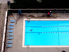 Laps (thetodd) Tags: blue chicago pool swimmingpool swimmer lakeview viewfromabove poolboy june2007