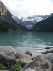 Late evening on Lake Louise (peggyhr) Tags: summer ice water rocks glacier alberta lakelouise 2007 canadianrockies emeraldgreen abigfave peggyhr