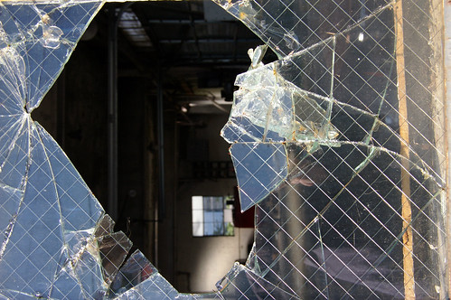 A broken window used as an illustration for an article about miserable failure