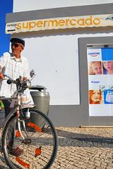 still cool (astroturtle) Tags: street old man portugal bicycle cool nikon grandfather supermarket cobblestone supermercado d80 villarealdesantoantonio ilustrarportugal