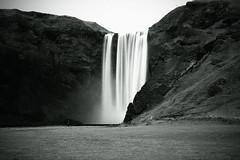 Iceland - Skgafoss (josche) Tags: white black water island waterfall iceland wasser long exposure wasserfall time schwarz skogafoss weis eyjafjallajkull