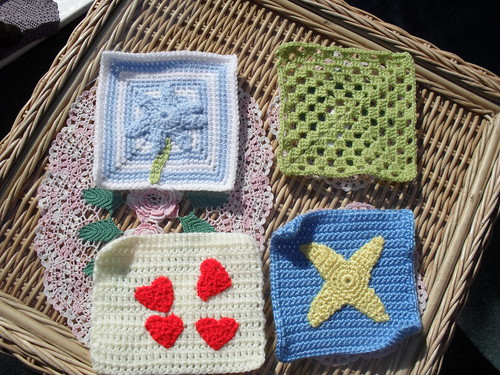 Margaret (UK) Thank you for the Squares, they arrived today! Flower theme, Strawberries and Cream, picture theme and a Granny. I love them thank you!
