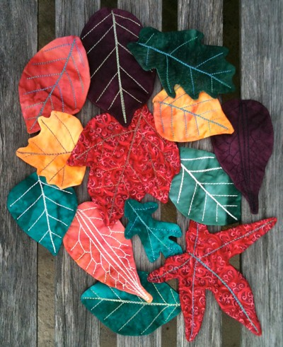 Quilted autumn leaves wall hanging (on my garden bench)