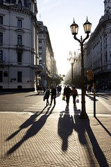 xing long shadows (micmol ) Tags: people group argentina buenos aires capital federal pampa south america port diagonal norte plaza de mayo backlighting shadow shade floor man woman couple love loving care brace hug hugging walk together street crossing jay respect sign posterity vertical bsas buenosaires ar