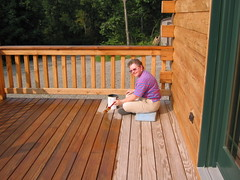 Terry staining the deck.