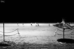 Playing on the beach (polline) Tags: beach night blackwhite bn minimal morocco marocco spiaggia essaouira calcio polline ombrellone sigma24mm18