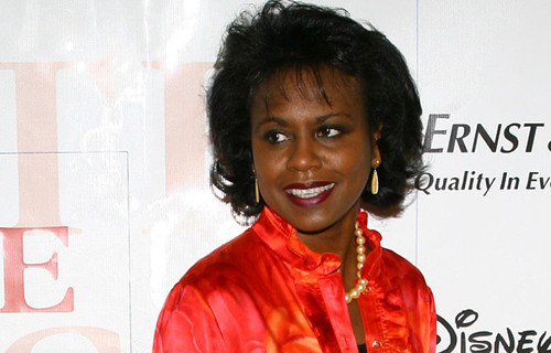 Anita Hill looking confident and happy in a red suit