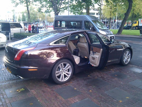 Driving from the Bilderberg Parkhotel to the Erasmus University. Nice Jaguar again ;)