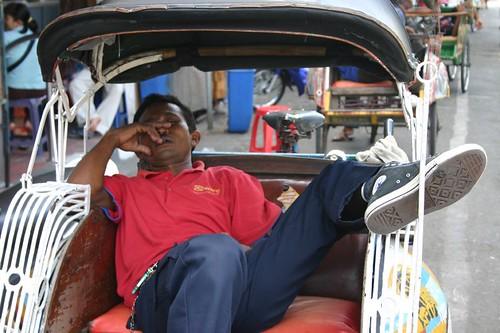 Sleepy becak driver in Yogyakarta