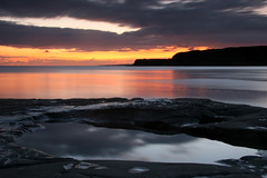 Kimmeridge (mind the goat) Tags: sunset sea sky orange sun reflection pool rock bay coast south calm dorset kimmeridge rockpool clould