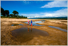 In the land of landscapes - XII (Catch the dream) Tags: girls sky reflection nature water pool clouds river landscape sand hills poodle sylhet bangladesh peopleinnature gettyimagesbangladeshq2