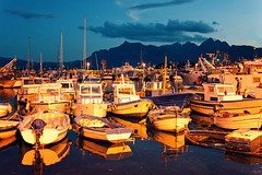 Blue Hour At The Fishing Port (Philipp Klinger Photography) Tags: travel italien blue light sunset shadow sea sky italy orange cloud mountain fish cold reflection nature water lamp yellow clouds port marina landscape evening harbor boat mar al fishing nikon meer warm europa europe mediterranean italia mare ship harbour availablelight hour fisher sicily bluehour philipp sodium sicilia sodiumvapor klinger sizilien porticello d700 sigma50mmf14 vanagram mediterrananeansea
