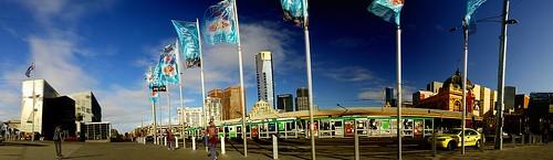 street people urban autostitch panorama tower nikon cityscape d70 pano australia federationsquare melbourne victoria flags pedestrians eureka eurekatower stkildard flindersststation polariser 14xp 1855mmf3556gii