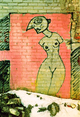 HIPS (stOOpidgErL) Tags: pink woman film yellow wall naked breasts grafitti detroit 2006 scan hips armless analogphotography amputee stoopidgerl canonti
