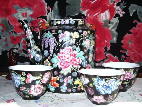 TEA SET WITH FLORAL BACKGROUND