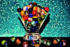 Glass marbles in a glass (Swissrock) Tags: november reflection art glass rainbow nikon colours shine round swirl marble glas christal murmeln 2010 glaskugeln kugeln d700 52weeksofpix 52pix