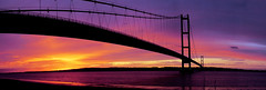 Panoramic sunset at Humber Bridge (Corica) Tags: uk greatbritain bridge sunset england panorama silhouette photoshop yorkshire lincolnshire casio hull humberbridge humber exp600 panoramamaker corica eastridings