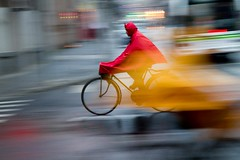 Liftoff! (jrodmanjr) Tags: china street city travel urban motion blur wet rain bike bicycle night movement asia shanghai streak metro pan prc panning shanghaiist poncho metropolitan peoplesrepublicofchina dateshift lpbikes
