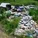 Random pile of trash behind a storage shed
