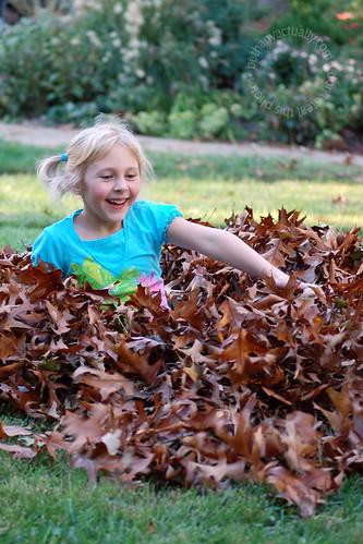 Annalie in a leaf pile