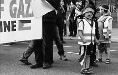 Gaza Flotilla Protest Dublin 30.05.2010 5 (Anthony Cronin) Tags: street analog photography all politics religion protest rights waters hp5 zion zionism humanrights seige irelanddublin lifeliving dublinlife photographystreet hp5ilford dublindublin dublinirish f8050mm streetdublin mavimarmara streetsdublin reservedirish photographystreets dublindublinersinside dublinliving conventioninternational dublinirelandnikon f14dy48 filteranthony croninanalogsimpliciusapug35mmfilm© irelandxtol11filmdevrecipe5424kodakkodak xtolilfordhp5ilford 400gaza flotillafreedom flotillaisraeloccupationsiegewwwipsciepalestinegazageneva tpastreet photangoirl