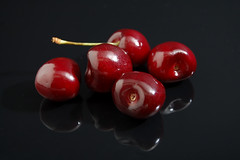 Five Cherries (Photoshoparama - Dan) Tags: red blackbackground fruit cherries sb800 desktopstudio strobist johnsongraphics photoshoparama danielejohnson crossroadonecom