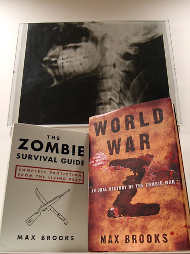 Zombie Survival Guide and World War Z, by Max Brooks. And a skull
