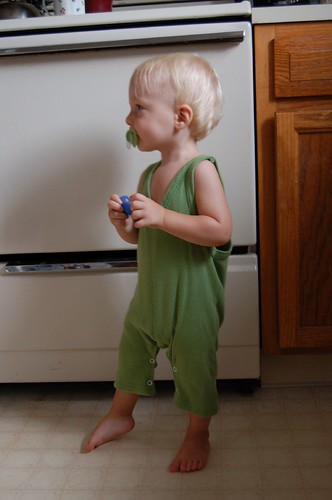 Boy in green with matching pacifier
