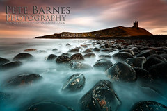Dunstanburgh Castle (Pete Barnes Photography) Tags: sea motion castle art beach nature wet water studio landscape photography rocks waves moody photographer stones dramatic pebbles cliffs northumberland dunstanburgh dunstanburghcastle landscapephotography landscapephotographer