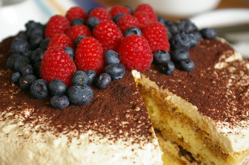 Tiramisu cake topped with berries. In this recipe