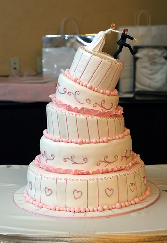 toppling quadruple-decker cake photo
