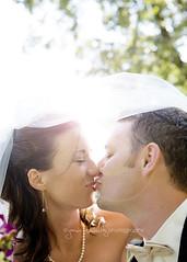 The kiss.... (jamiesphoto) Tags: wedding kiss couple sunflare