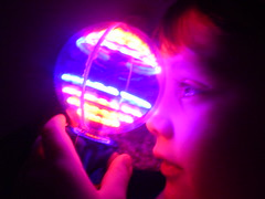 cruxien glows (shimmer.glimpse.) Tags: toy lights boychild