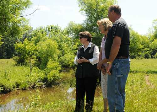 Agriculture Deputy Secretary Kathleen Merrigan looks over the creek at the farm of Mrs. Eby-Patterson and husband, Daniel. They are using new sustainable conservation techniques to keep their creek clean and to help improve the health of the Chesapeake Bay on their farm in Hershey, PA, on Friday, June 18, 2010.