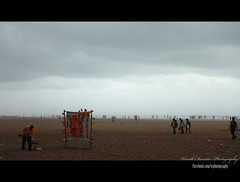 Foggy Marina Beach (VinothChandar) Tags: sea people india storm beach water rain fog marina canon balloons relax photography coast photo seaside waves wind weekend hurricane sunday crowd madras group balloon foggy tsunami coastal rainy photograph monsoon enjoy beaches marinabeach chennai seashore cyclone tamil climate tamilnadu jal southindia rainyseason windstorm tamizh balloonshooting
