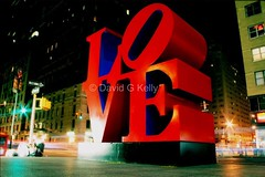 And The Word Is... (Dave G Kelly) Tags: street city nyc longexposure red sculpture ny newyork art love night lights nocturnal manhattan nightshift popart nighttime publicart lovelovelove sixthavenue robertindiana lovesculpture 10faves aplusphoto davegkelly