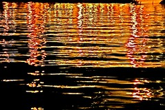 Rafina water ripples II - IMG_6947 ed (Dimitris Papazimouris) Tags: sea abstract water colors night reflections greek nightshot greece ripples rafina canon30d canon24105f4