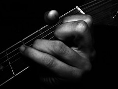 Music Soothes the Soul (lowbattery) Tags: blackandwhite bw white black contrast self dark hand guitar fingers flight grimey clenched imagesofself