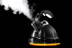 Tea kettle (canbalci) Tags: orange black hot cooking water kitchen metal silver shiny glow tea metallic steel flash over sb600 steam gourmet pot kettle stove heat reflective teapot heating stainless boiling 2007 steaming boil kitchenware strobist worldphotodoc2007 world100f