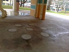 """Solve"" the old folks playing cards at the void deck problem by removing the stone table and chairs"