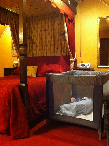 Owen takes a nap in the 4 poster bed room