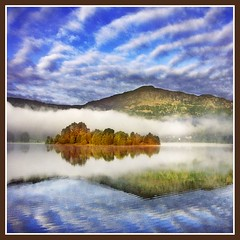 Beginning of Autumn (adrians_art) Tags: blue trees light sky white mist mountains water weather misty clouds reflections dark landscape geotagged bravo grasmere lakes cumbria naturesfinest geotags magicdonkey outstandingshots abigfave impressedbeauty aplusphoto ultimateshot holidaysvacanzeurlaub superbmasterpiece wowiekazowie diamondclassphotographer blackribbonbeauty theroadtoheaven
